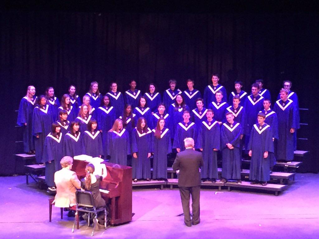 Frank Lewis directs the concert choir at the spring choral performance. Photo courtesy of Bellarmine Prep Twitter