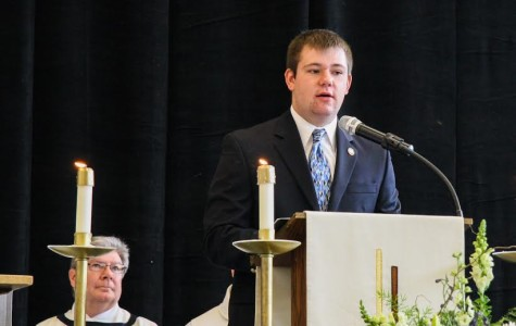 Alex Cranstoun reads to the student body at the St Robert Bellarmine All School Mass in 2013.  Photo courtesy of Alex Cranstoun