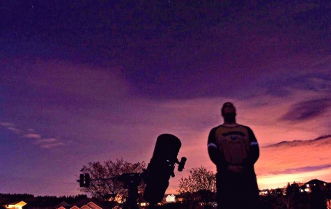 Amateur astronomer Paul Gicewicz observes the evening sky and anticipates a night of stargazing. Photo courtesy of Paul Gicewicz