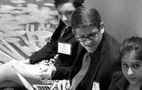 Students work together at the Model UN conference. Photo courtesy of Alec Ilstrup Media