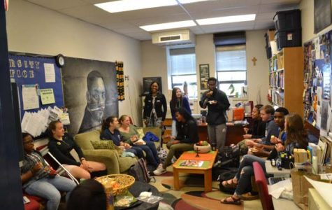 Students hang out during lunch in the Diversity Office. Photo by Peter Gray