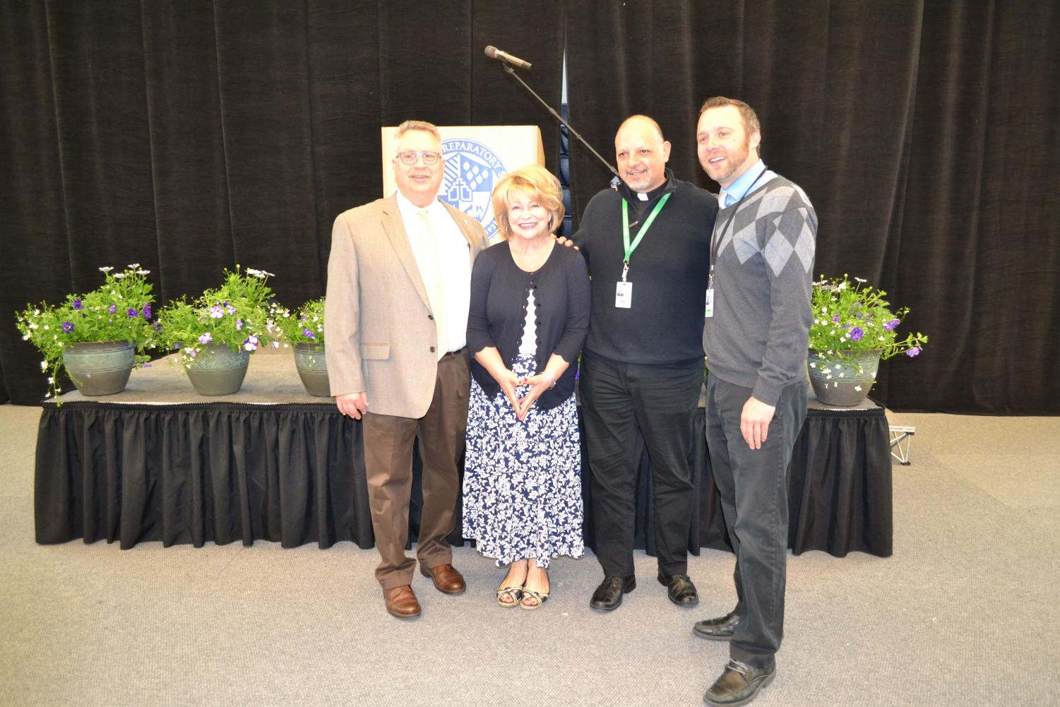 Jim Fish, Judy Torgerson, Fr. Tom Lamanna, S.J. and Erik Michels will be leaving at the end of the year. Not pictured: Kirsten Byers, Julie Campbell, Denise Diaz and Frank Lewis. Photo by Jeanne Hanigan