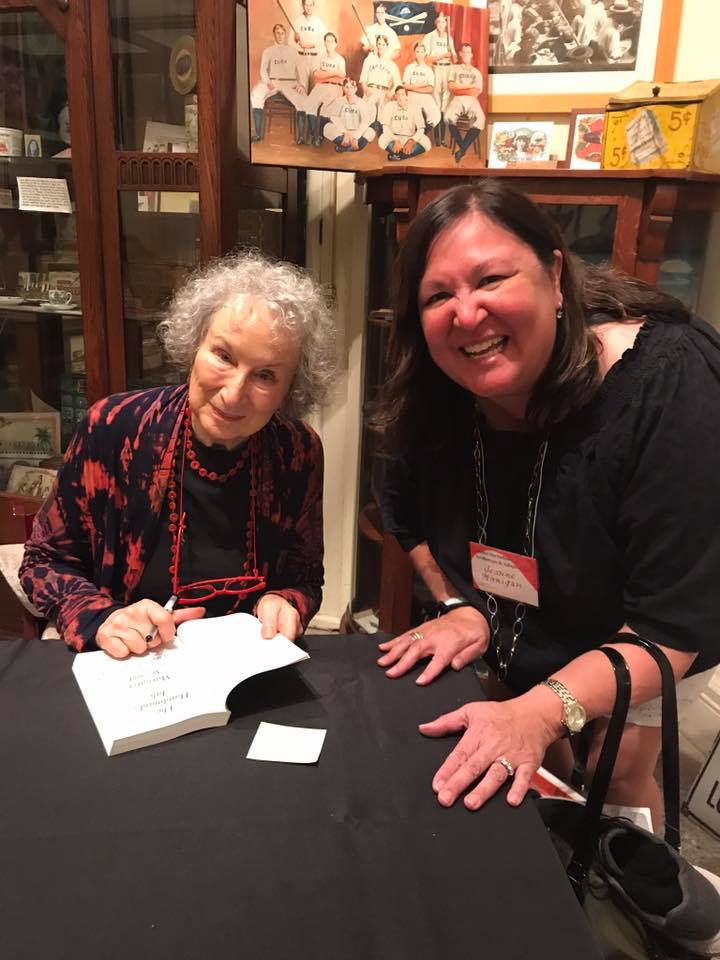 Margaret Atwood signs a copy of