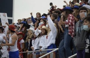 """The student section for Bellarmine's second home game against Curtis on Sep. 16 is pictured here in their """"Red, White and Cowboy"""" attire. Photo courtesy of the bellarmine_prep Instagram."""